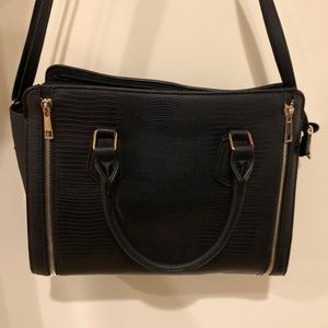 Black purse with gold zipper accents